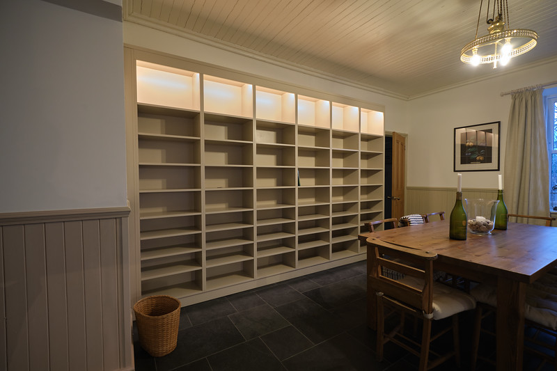 3.5m x 2.4m painted bookcase  in painted birch ply with full adjustable shelves and concealed lighting