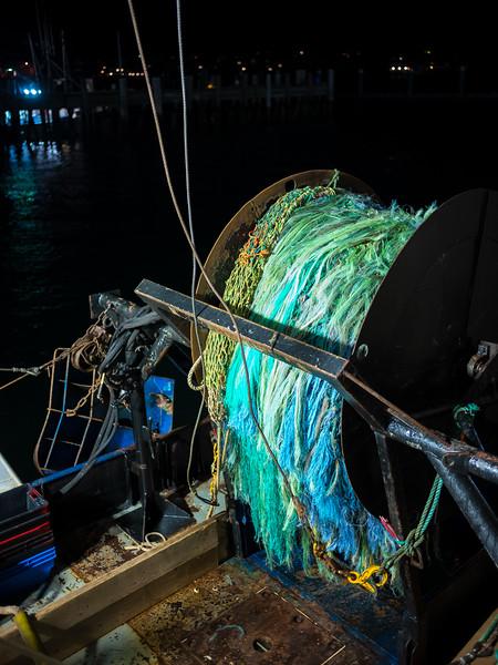 spooled fishnet on boat.jpg