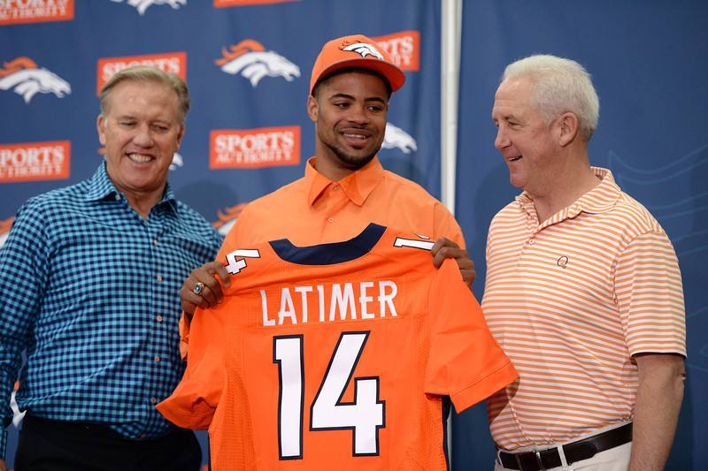 . John Elway, left, and John Fox, right, introduce WR Cody Latimer from Indiana University in the second round of the 2014 NFL draft. Centennial, Colorado. May 10. (Photo by Hyoung Chang/The Denver Post)