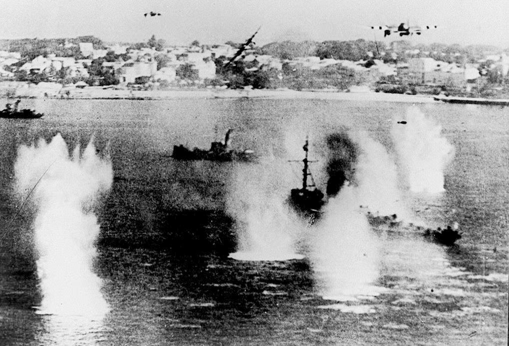 Description of . Allied ships are attacked by German fighters June 6, 1944 as the largest massed assault of World War II begins to land men and supplies on the coast of northern France. (FILES/AFP/Getty Images)