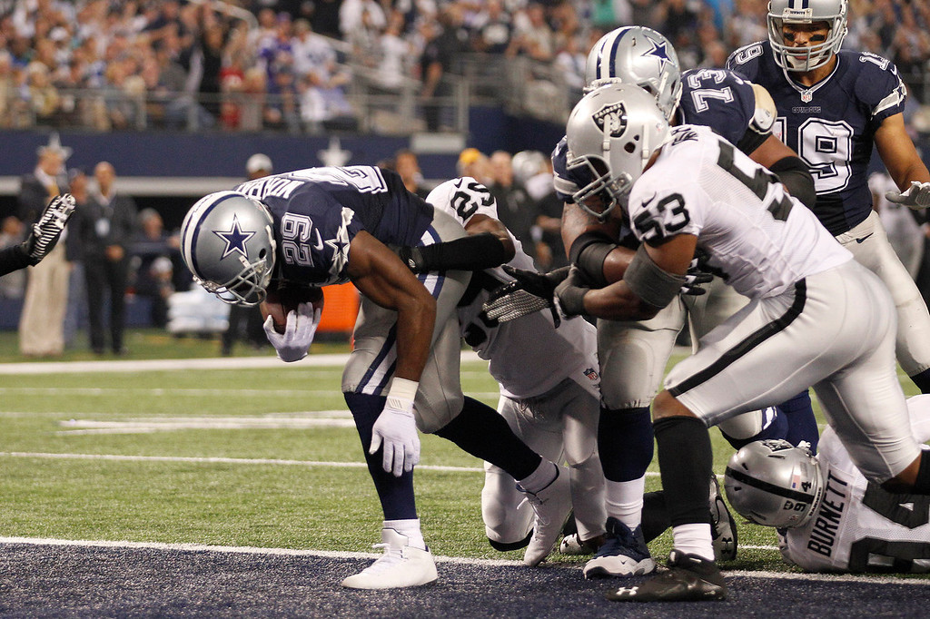 . Dallas Cowboys running back DeMarco Murray (29) scores a touchdown against the Oakland Raiders during the first half of an NFL football game, Thursday, Nov. 28, 2013, in Arlington, Texas.  (AP Photo/Tim Sharp)