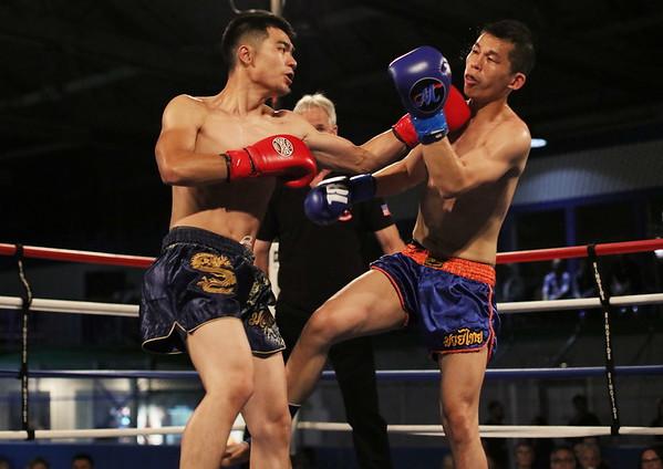 Andy Pathamavong (red) vs. Man Wong (blue)