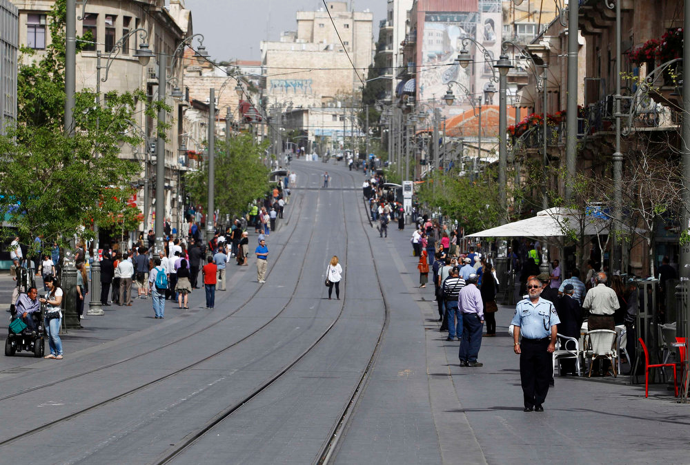 . People stand still on a street as a two-minute siren marking Holocaust Remembrance Day is sounded in Jerusalem on April 8, 2013. Israel on Monday marks the annual memorial day commemorating the six million Jews killed by the Nazis in the Holocaust during World War II. REUTERS/Baz Ratner