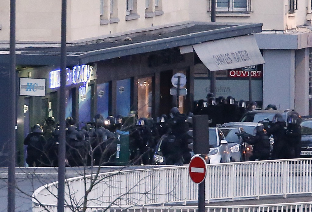 . Members of the French police special forces launch the assault at a kosher grocery store in Porte de Vincennes, eastern Paris, on January 9, 2015 where at least two people were shot dead on January 9 during a hostage-taking drama at a Jewish supermarket in eastern Paris, and five people were being held, official sources told AFP. Several hostages were freed after French commandos stormed a Jewish supermarket in eastern Paris where an assailant was holed up on January 9. After several explosions, police stormed the shop in Portes de Vincennes and everal hostages exited the store shortly afterwards and were taken to safety.   AFP PHOTO / THOMAS SAMSONTHOMAS SAMSON/AFP/Getty Images