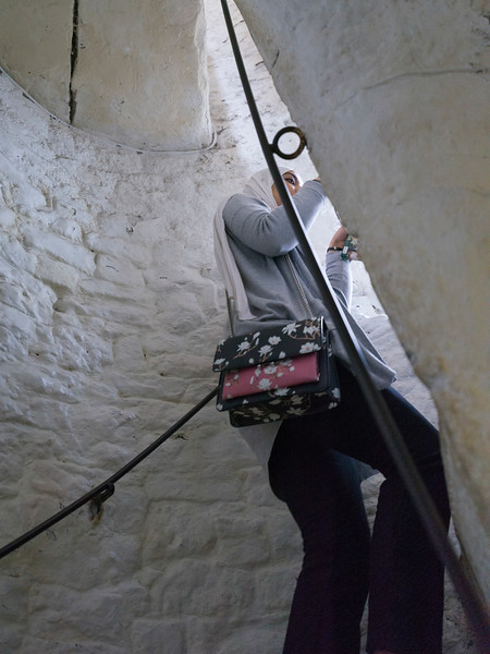 Woman moving up stairway, Bunratty Castle, Bunratty, County Clare, Republic of Ireland