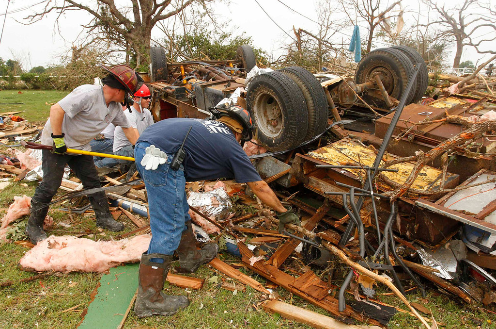 . Rescue workers comb through debris after tornados swept through the town of Granbury, Texas May 16, 2013. REUTERS/Richard Rodriguez