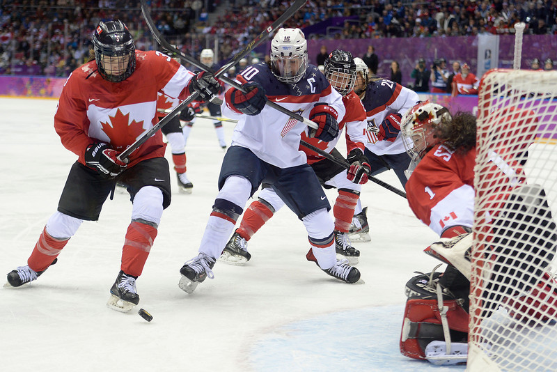 . Meghan Duggan (10) of the U.S.A. looks for a shot near the goal as Jocelyne Larocque (3) of the Canada and Shannon Szabados (1) of the Canada defend during the first period of the women\'s gold medal ice hockey game. Sochi 2014 Winter Olympics on Thursday, February 20, 2014 at Bolshoy Ice Arena. (Photo by AAron Ontiveroz/ The Denver Post)