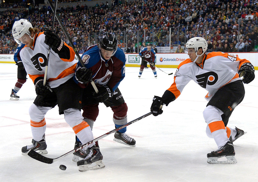 . Colorado Avalanche center Nathan MacKinnon (29) battles of the puck with Philadelphia Flyers center Sean Couturier (14) and Philadelphia Flyers center Vincent Lecavalier (40) during the third period January 2, 2014 at Pepsi Center. (Photo by John Leyba/The Denver Post)