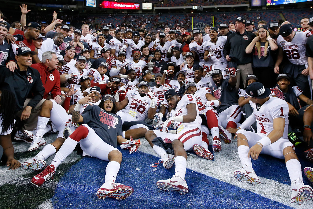 . NEW ORLEANS, LA - JANUARY 02:  Members of the Oklahoma Sooners celebrate their 45-31 win over the Alabama Crimson Tide during the Allstate Sugar Bowl at the Mercedes-Benz Superdome on January 2, 2014 in New Orleans, Louisiana.  (Photo by Kevin C. Cox/Getty Images)