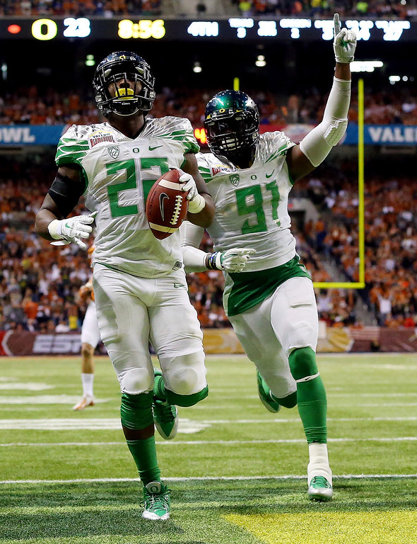. Linebacker Derrick Malone #22 of the Oregon Ducks returns an interception for a touchdown in the fourth quarter against the Texas Longhorns during the Valero Alamo Bowl at the Alamodome on December 30, 2013 in San Antonio, Texas.  (Photo by Ronald Martinez/Getty Images)