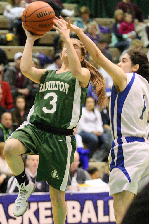 . Hamilton\'s Jessica Welsh (3) goes up for the shot as Ft Edwards  Brittni Sardina (1)  defends in the second half of the NYSPHSAA Class D semifinal in Troy on Saturday, March 15, 2014.JOHN HAEGER-ONEIDA DAILY DISPATCH @ONEIDAPHOTO ON TWITTER