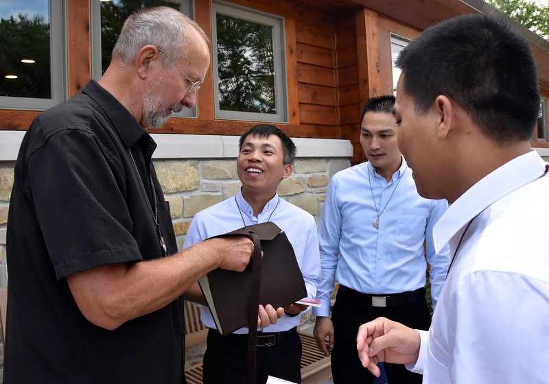 Fr. Byron has the novices sign the house book