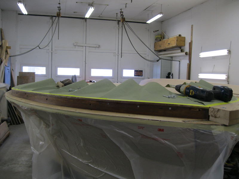 Front starboard view of cover boards being gluded in lace.