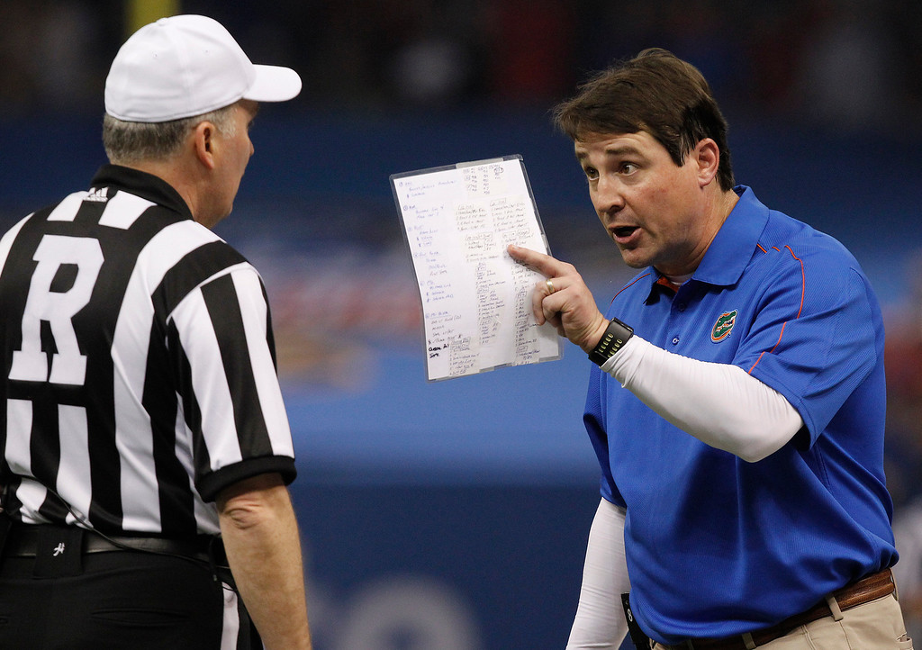 . Florida head coach Will Muschamp argues with an official in the first half of the Sugar Bowl NCAA college football game against Louisville Wednesday, Jan. 2, 2013, in New Orleans. (AP Photo/Butch Dill)