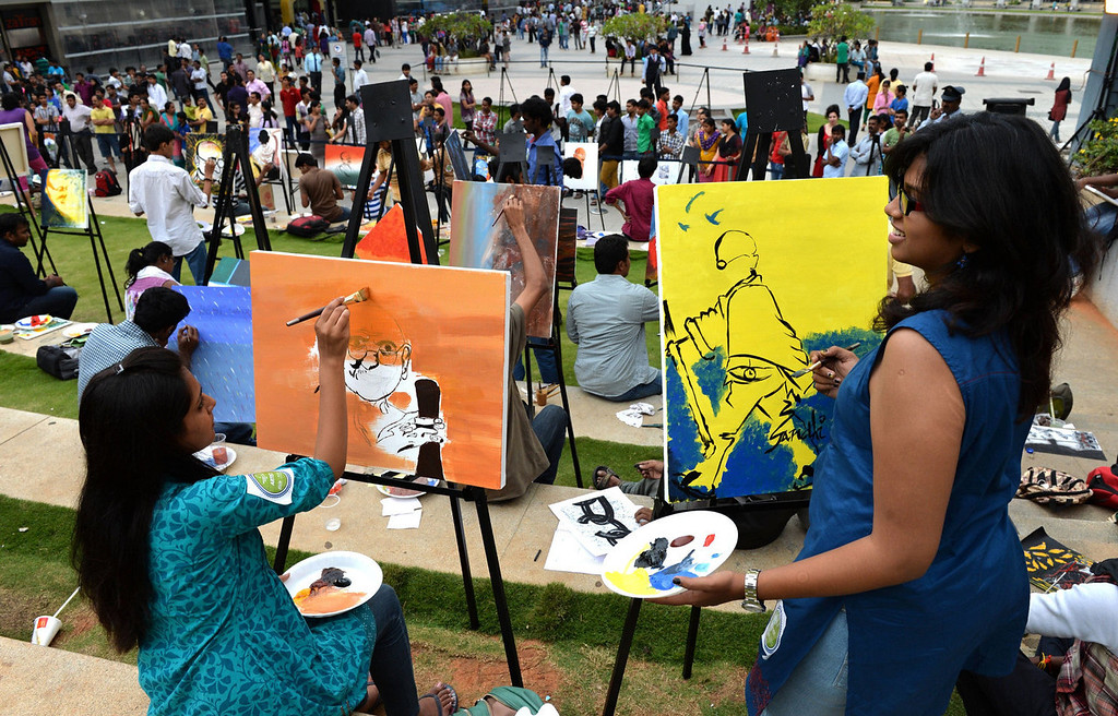 ". Indian artists participate in a painting movement titled ""Colours of Mahatma\"" held as part of the Gandhi Jayanthi Celebrations at a Mall in Bangalore on October 2, 2013.  144 artists took part in the painting marathon to mark the 144th birthday of The Father of the Nation, Mahatma Gandhi.   Manjunath Kiran/AFP/Getty Images"
