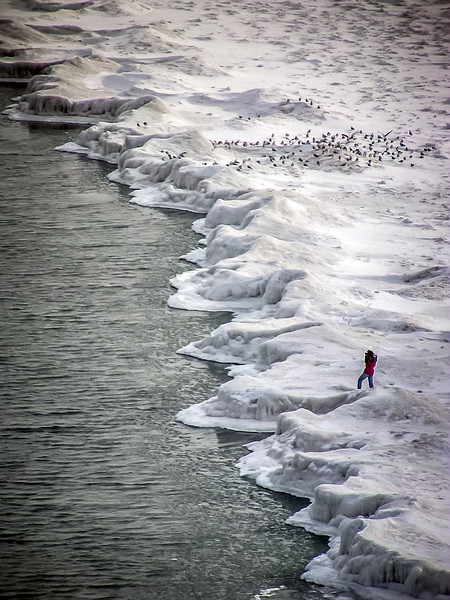 The photographer in red jacket, Lake Michigan, Edgewater. Chicago