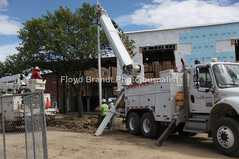Havre Daily News/Floyd Brandt  Construction at Montana State University Northern remove a light pole next to the new building by the student union building Tuesday.