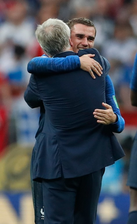 . France head coach Didier Deschamps hugs Antoine Griezmann, face to camera, at the end of the final match between France and Croatia at the 2018 soccer World Cup in the Luzhniki Stadium in Moscow, Russia, Sunday, July 15, 2018. France won 4-2. (AP Photo/Petr David Josek)