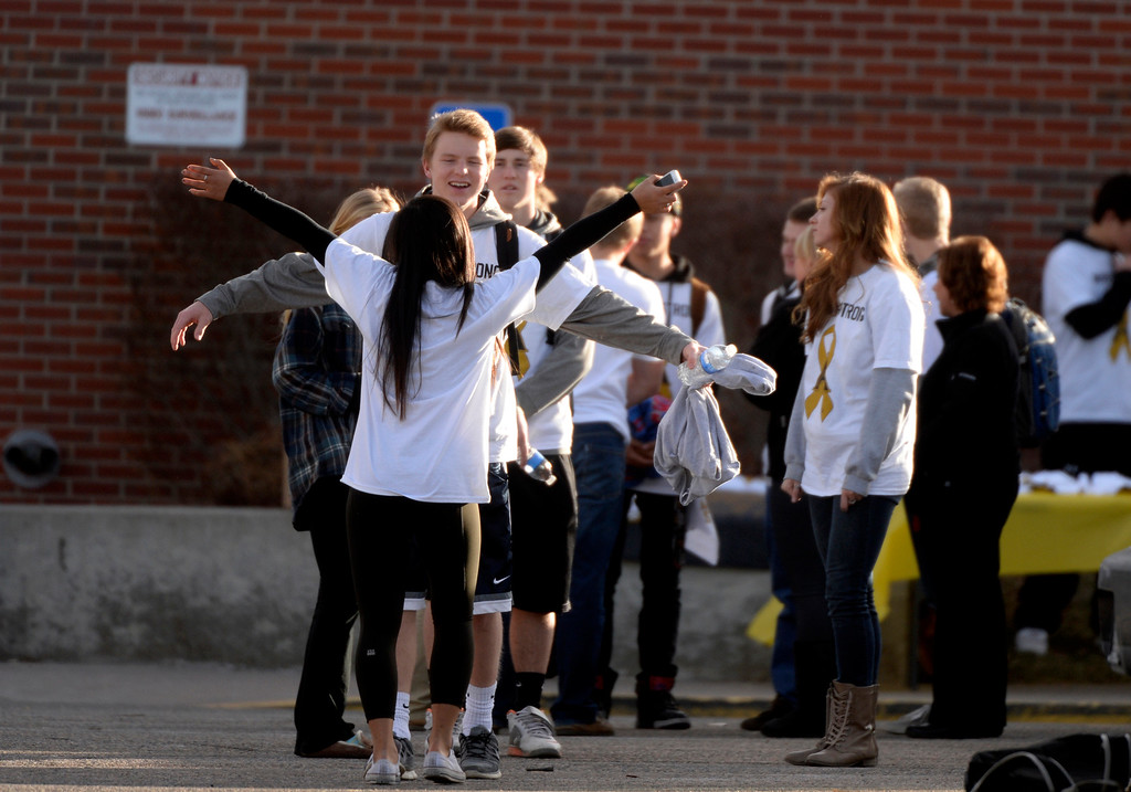 . Seniors gather outside Arapahoe High School in Centennial, CO December 19, 2013. Seniors and Juniors returned to the school for two hour periods Thursday, Sophomores and Freshmen will return on Friday. (Photo By Craig F. Walker / The Denver Post)