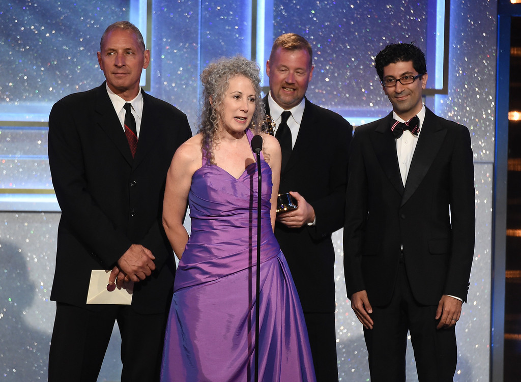. Director Jill Mitwell (C) and directing team accept Outstanding Drama Series Directing Team for \'One Life to Live\' onstage during The 41st Annual Daytime Emmy Awards at The Beverly Hilton Hotel on June 22, 2014 in Beverly Hills, California.  (Photo by Michael Buckner/Getty Images)