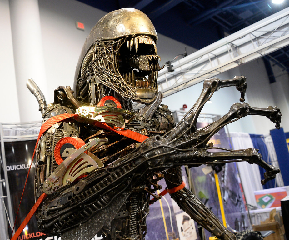 . Nov 6,2013 Las Vegas NV. USA. Quickloader the retractable tied down  straps hold down a life size Alien made out of auto parts, during the second day of the 2013 SEMA auto show. Photo by Gene Blevins/LA Daily News
