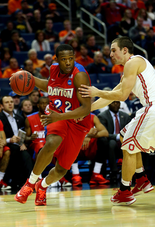 . Kendall Pollard #22 of the Dayton Flyers drives to the basket as Aaron Craft #4 of the Ohio State Buckeyes defends during the second round of the 2014 NCAA Men\'s Basketball Tournament at the First Niagara Center on March 20, 2014 in Buffalo, New York.  (Photo by Elsa/Getty Images)