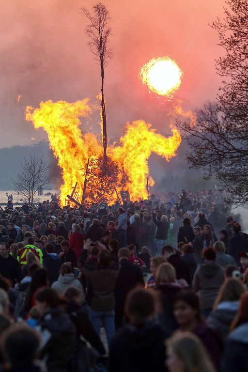 . Spectators watch a traditional Easter Fire on the eve of Easter Sunday, April 19, 2014 on the banks of the river Elbe in Hamburg\'s Blankenese district, northern Germany.    AFP PHOTO / BODO MARKS / /AFP/Getty Images