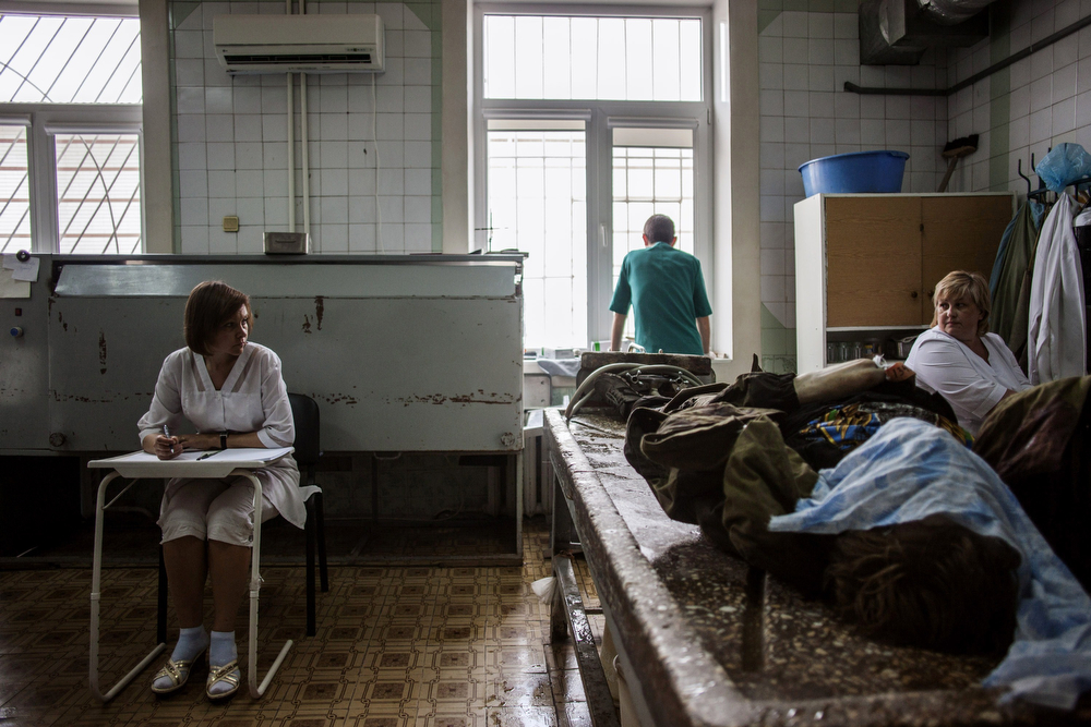 . Ukrainian medical staff prepare to clean the body of a killed pro-Russian fighter at the Kalinina morgue in the eastern Ukrainian city of Donetsk, on May 27, 2014. Ukraine said today it had regained control of the airport in the eastern city of Donetsk after a day of punishing air strikes and fierce fighting with pro-Moscow separatist gunmen left dozens of people dead. (FABIO BUCCIARELLI/AFP/Getty Images)