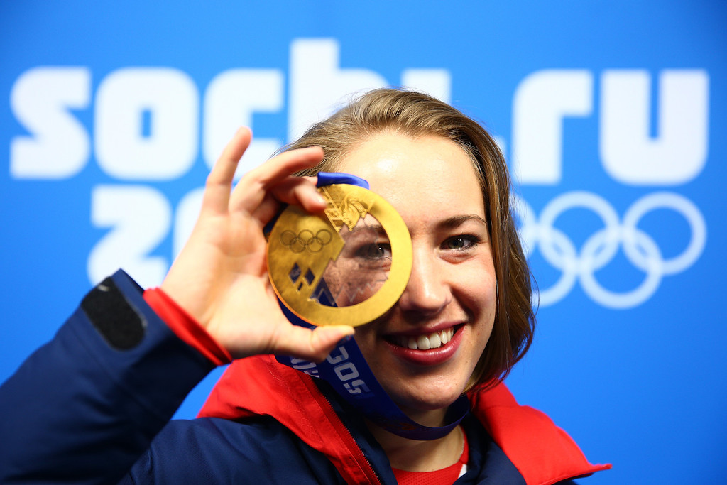 . SOCHI, RUSSIA - FEBRUARY 15:  Gold medalist Lizzy Yarnold of Great Britain celebrates during the medal ceremony for the Women\'s Skelton on day 8 of the Sochi 2014 Winter Olympics at Medals Plaza on February 15, 2014 in Sochi, Russia.  (Photo by Clive Mason/Getty Images)