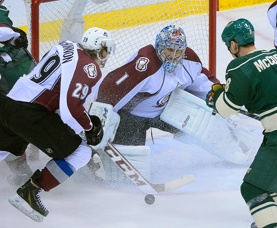 . Nathan MacKinnon helped clear the puck after Semyon Varlamov made a save in the first period. The Minnesota Wild hosted the Colorado Avalanche Monday night, April 28, 2014 at the Xcel Energy Center in St. Paul. (Photo by Karl Gehring/The Denver Post)