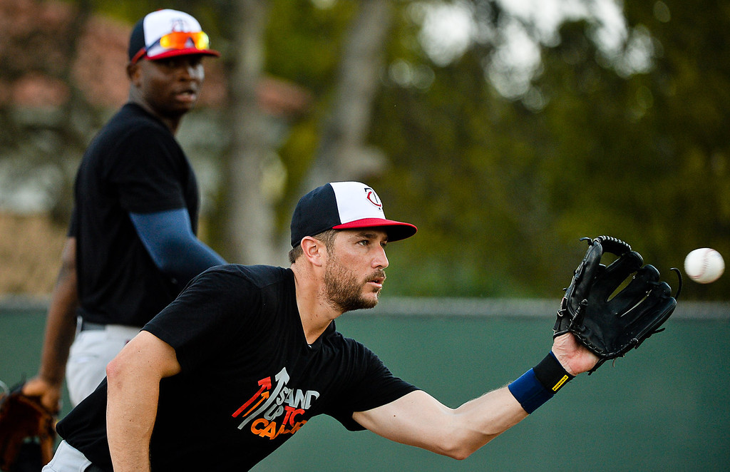 ". Twins third baseman Trevor Plouffe catches the ball as Miguel Sano watches during Kelly\'s famous ""Good Morning America\"" drill. (Pioneer Press: Ben Garvin)"