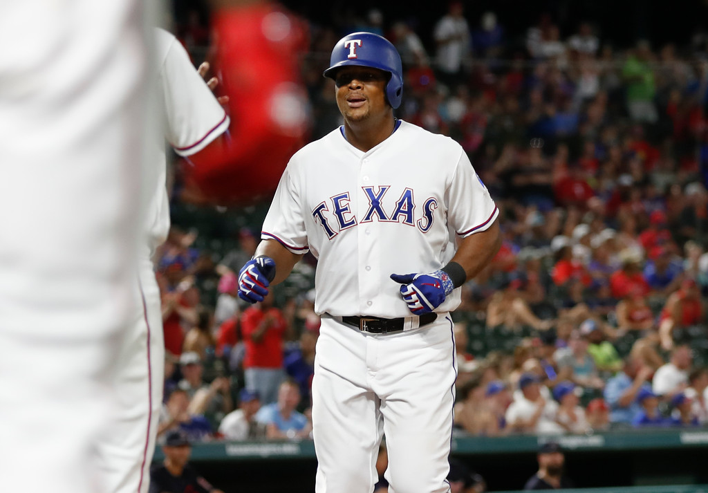 . Texas Rangers\' Adrian Beltre, right, is greeted by teammates following his two-run home run against the Cleveland Indians during the seventh inning of a baseball game, Saturday, July 21, 2018, in Arlington, Texas. (AP Photo/Jim Cowsert)