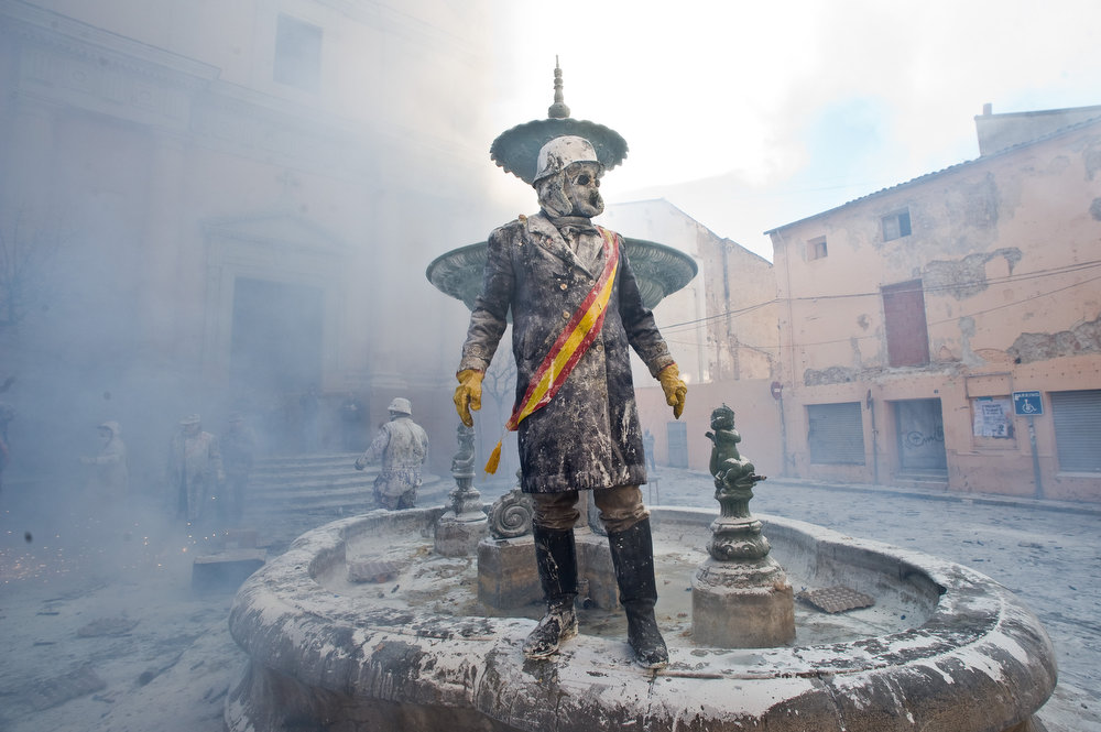 . A Reveller takes part in the battle of \'Enfarinats\', a flour fight in celebration of the Els Enfarinats festival on December 28, 2012 in Ibi, Spain. Citizens of Ibi annually celebrate the festival with a battle using flour, eggs and firecrackers. The battle takes place between two groups, a group of married men called \'Els Enfarinats\' which take the control of the village for one day pronouncing a whole of ridiculous laws and fining the citizens that infringe them and a group called \'La Oposicio\' which try to restore order. At the end of the day the money collected from the fines is donated to charitable causes in the village. The festival has been celebrated since 1981 after the town of Ibi recovered the tradition but the origins remain unknown.�  (Photo by David Ramos/Getty Images)