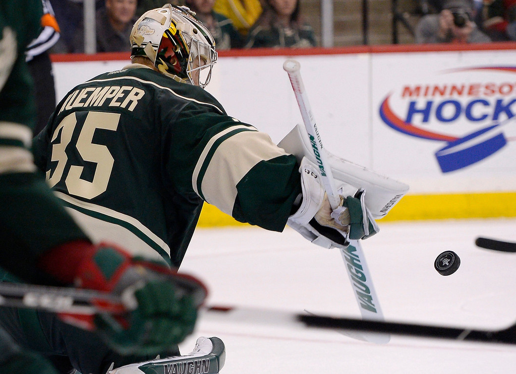 . Minnesota Wild goalie Darcy Kuemper (35) makes a save law in the third period against the Colorado Avalanche April 24, 2014 in Game 4 of the Stanley Cup Playoffs at Xcel Energy Center. (Photo by John Leyba/The Denver Post)
