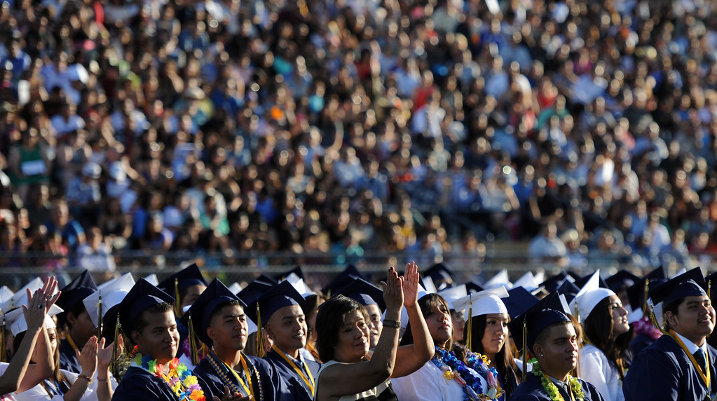. Students along with family and friends look on during the Montebello High School commencement at Montebello High School on Thursday, June 20, 2013 in Montebello, Calif.  (Keith Birmingham/Pasadena Star-News)