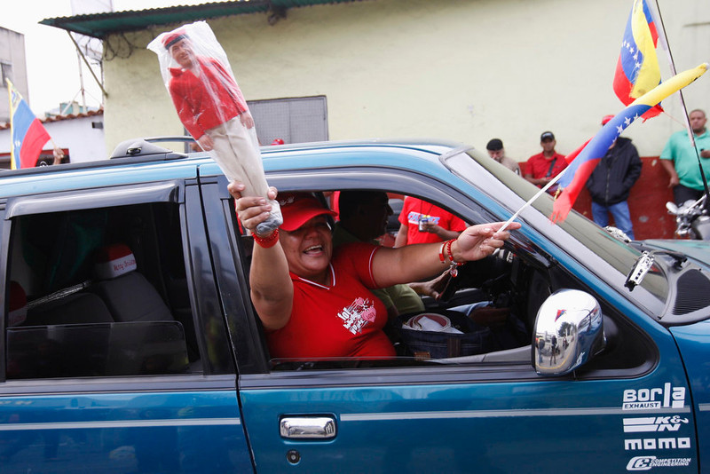 . Supporters of Venezuela\'s President Hugo Chavez cheer outside the military hospital after his surprise return to Caracas February 18, 2013. Chavez made a surprise return from Cuba on Monday more than two months after surgery for cancer that has jeopardized his 14-year rule of the South American OPEC member. The 58-year-old socialist leader underwent a six-hour operation in Cuba on December 11. He had not been seen or heard in public since then until photos were published of him on Friday. REUTERS/Edwin Montilva