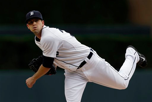 . Detroit Tigers pitcher Drew Smyly throws a warmup pitch against the Minnesota Twins in the first inning of a baseball game in Detroit, Friday, June 13, 2014.  (AP Photo/Paul Sancya)