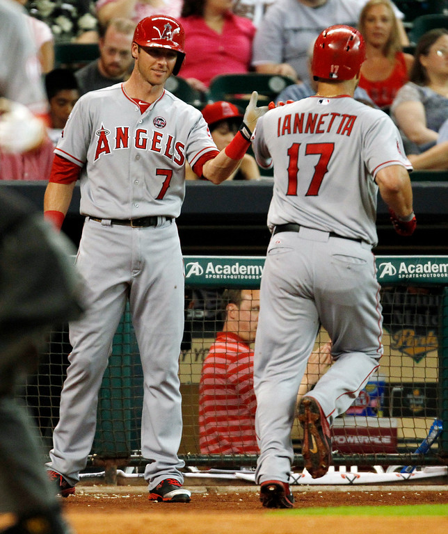 . Los Angeles Angels Chris Iannetta, right, celebrates his solo home run with Andrew Romine in the third inning of a baseball game against the Houston Astros Saturday, Sept. 14, 2013 at Minute Maid Park in Houston. (AP Photo/Eric Christian Smith)