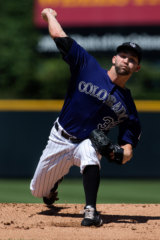 . Starting pitcher Tyler Chatwood #32 of the Colorado Rockies delivers to home plate during the first inning against the Chicago Cubs at Coors Field on July 21, 2013 in Denver, Colorado.  (Photo by Justin Edmonds/Getty Images)