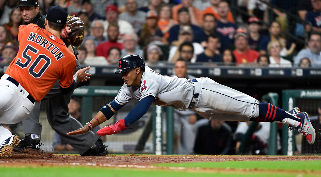 . Cleveland Indians\' Francisco Lindor, right, attempts to score past Houston Astros starting pitcher Charlie Morton (50) during the fifth inning of a baseball game, Friday, May 19, 2017, in Houston. Lindor was tagged out by Morton on the play. (AP Photo/Eric Christian Smith)