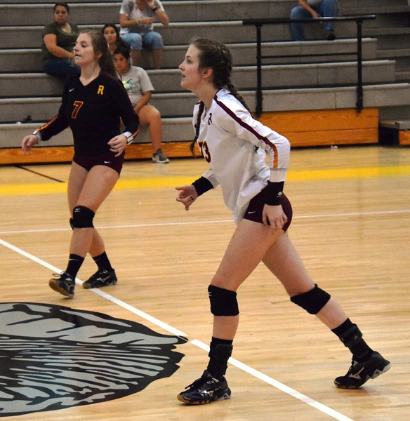 Riverview's Laura Szkarlat (7) and Abbie Malinowski get ready for action on Monday night at Flat Rock. The visiting Pirates ultimately fell by a score of 3-2 (22-25, 25-18, 11-25, 25-21, 15-13). Alex Muller - For Digital First Media