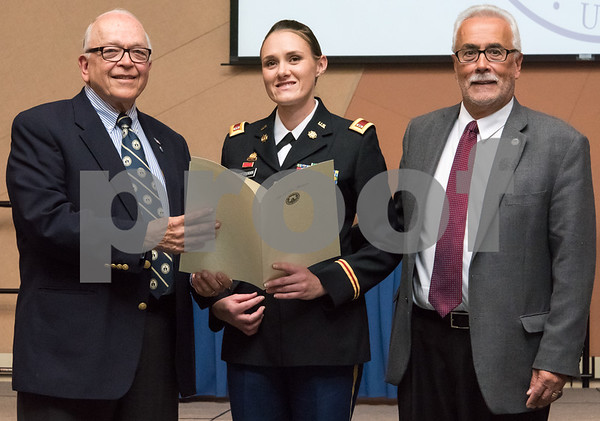 11/09/17 Wesley Bunnell | Staff CCSU held a Veterans Day Observance Ceremony on Friday afternoon in Alumni Hall. Alderman Don Naples, L, and Alderman Daniel Salerno, far R, present CCSU student and CT Army National Guard Chief Warrant Officer 2 Tasha E. Dow with an award from the city.