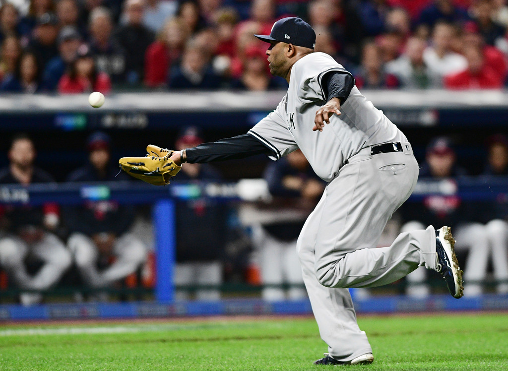 . New York Yankees starting pitcher CC Sabathia fields a bunt by Cleveland Indians\' Roberto Perez during the third inning of Game 5 of a baseball American League Division Series, Wednesday, Oct. 11, 2017, in Cleveland. Perez was out on the play. (AP Photo/David Dermer)