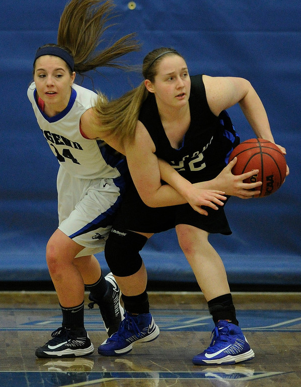 . PARKER, CO. - FEBRUARY 15: Falcons senior Cassie Currie (22) wrestled a rebound from Titans guard Kaitlin Ludwig (14) in the second half. The Highlands Ranch High School girls\'s basketball team defeated Legend 76-31 Friday night, February 15, 2013. Falcon\'s coach Caryn Jarocki earned her 500th career win. (Photo By Karl Gehring/The Denver Post)