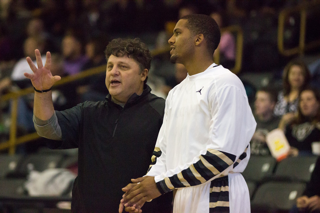 . Coach Greg Kampe speaks with guard Duke Mondy at the start of the second half of their exhibition with Tiffin Tuesday, Oct. 29, 2013 at the Athletics Center O\'rena.. Photo by Dylan Dulberg