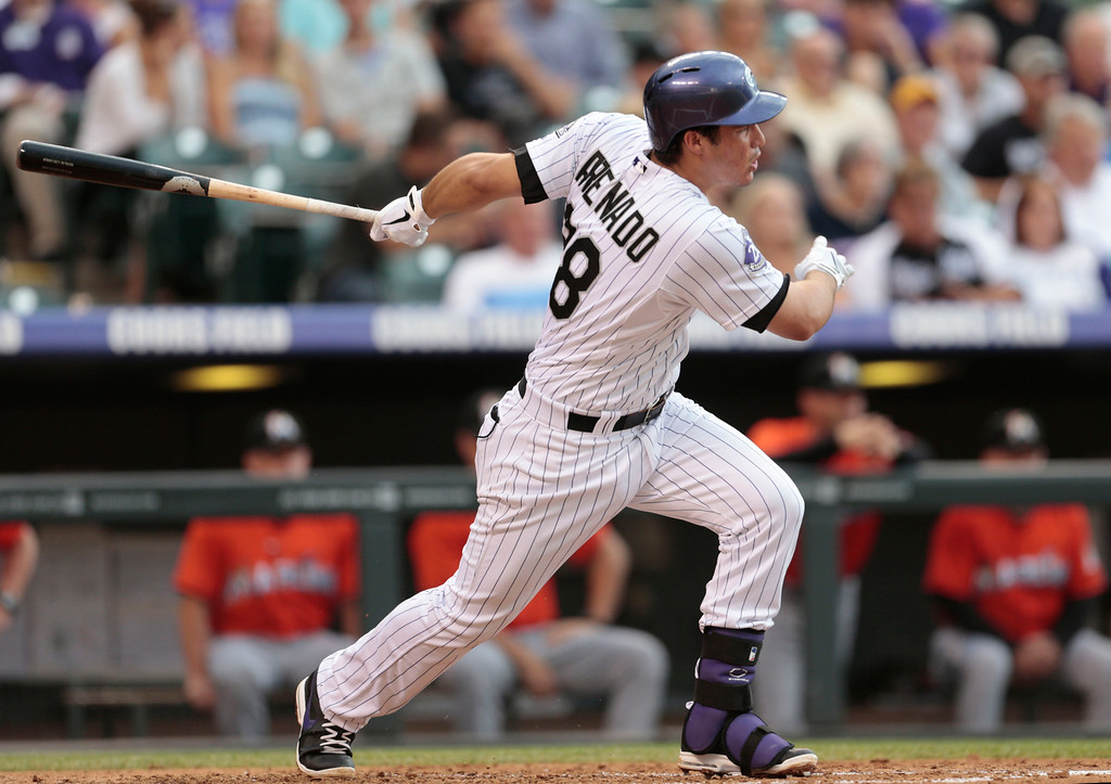. Colorado Rockies\' Nolan Arenado hits an RBI-single against the Florida Marlins in the second inning of a baseball game in Denver, Wednesday, July 24, 2013. (AP Photo/Joe Mahoney)