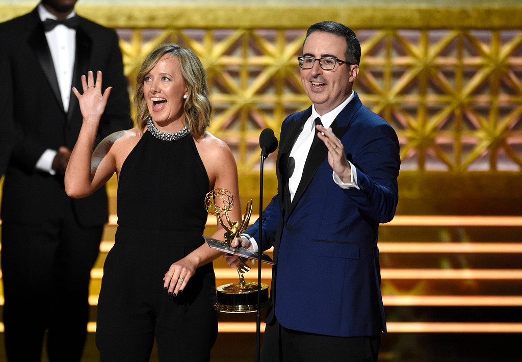 ". Liz Stanton, left, and John Oliver of ""Last Week Tonight with John Oliver\"" accept the award for outstanding variety talk series at the 69th Primetime Emmy Awards on Sunday, Sept. 17, 2017, at the Microsoft Theater in Los Angeles. (Photo by Chris Pizzello/Invision/AP)"
