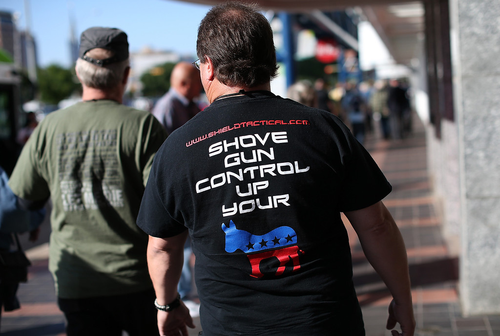 . HOUSTON, TX - MAY 03:  An attendee wears a Anti-gun control t-shirt during the 2013 NRA Annual Meeting and Exhibits at the George R. Brown Convention Center on May 3, 2013 in Houston, Texas.  More than 70,000 peope are expected to attend the NRA\'s three-day annual meeting that features nearly 550 exhibitors, gun trade show and a political rally. The Show runs from May 3-5.  (Photo by Justin Sullivan/Getty Images)