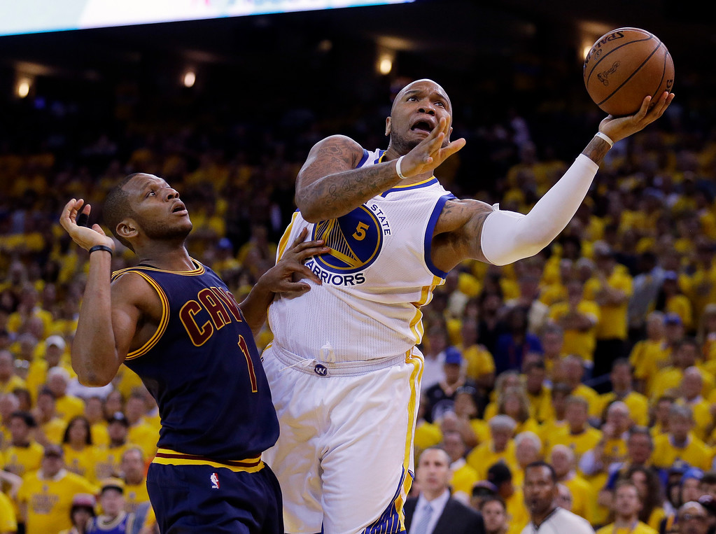 . Golden State Warriors forward Marreese Speights (5) shoots against Cleveland Cavaliers forward James Jones (1) during the second half of Game 1 of basketball\'s NBA Finals in Oakland, Calif., Thursday, June 4, 2015. (AP Photo/Ben Margot)