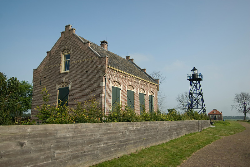 Building with water tower in Schokland, Netherlands